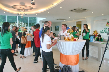 Local realtors mingle with sales staff at the Grande Caribbean agents' day, held August 25.