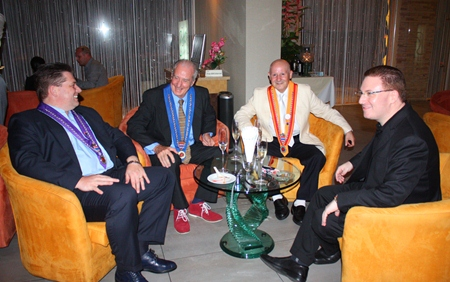 (L to R) Alfred Madl, Dr. Iain Corness, Guido Vietri and Ben Abrahams have a friendly conversation over some white wine.