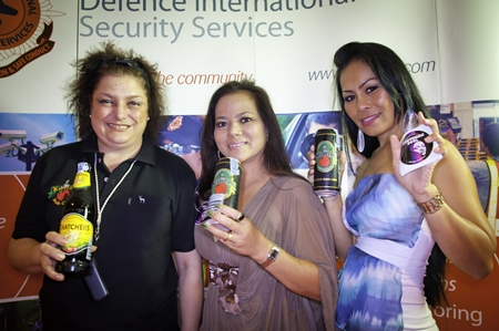 Selina Lazzarini, left, shows off her popular cider, with Onuma Willmore and Jom Arisa Ch.