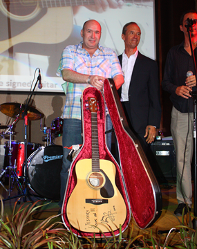 Ronny Gorrie held his nerve and with a final bid of B420,000 took home the Jimmy Page signed guitar inscribed with best wishes to Jesters Care for Kids.