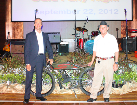 Woody and Bill proudly show off the vintage Harley up for grabs in the auction.