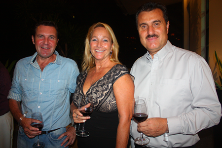 (L to R) Paul Wilkinson, along with Roseanne and Michael Diamente sample the wine before dinner.