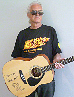 Jimmy Page came back to play some more on the guitar he is donating.