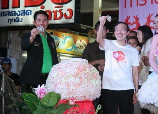 Mayor Itthiphol Kunplome (left) and UN Population Fund representative Dr. Taweepsap Siraprapassiri (right) hold up female condoms during Pattaya's participation in the 1st ever Global Female Condom Day.