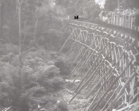 Three-Tier Trestle with train heading toward Hin Tok Cutting. The black rectangles represent where the backs of the three members of the Young Marines would have been located.