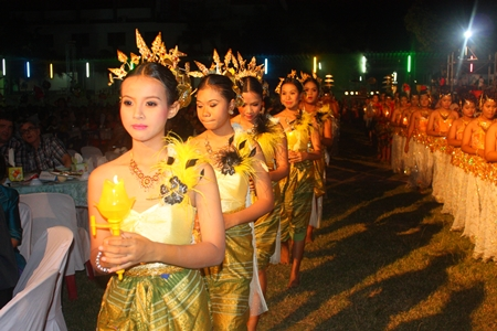 In a grand procession, students carry in a student with the royal award to be presented to school officials.