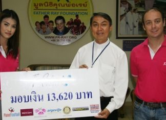 Oussaneeya Puekthong, left, and Jeremy Akoum, right, proprietors of The Perfume House, present a donation of 13,620 baht to Father Peter Srivorakul C.Ss.R., president of the Father Ray Foundation in Pattaya. The donation is the proceeds from an annual soccer competition which is organized by The Perfume House and won this year by the team from the Father Ray Children's Home.