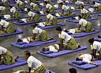 Thai masseuses perform mass massaging at a sports arena on the outskirts of Bangkok, Thursday, Aug. 30. Thailand has long been known as the massage capital of the world. Now, it has a Guinness World Record to prove it when some 641 massage therapists mass-massaged 641 people simultaneously for 12 minutes to win the honor Thursday. The event was organized by the Health Ministry to promote the Southeast Asian nation's massage and spa industry. (AP Photo/Apichart Weerawong)