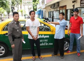 Taxi driver Peera Saeneesot points to Thongchai Khucharoen, the man who stole his taxi.