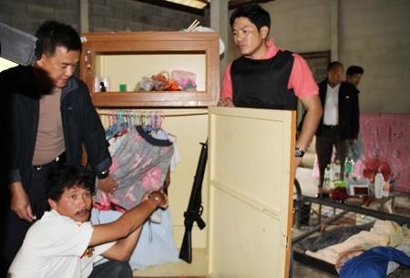 Chirawat Seuasing (bottom) shows police where the gun was hidden.