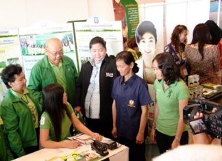 Culture Minister Sukumol Kunplome (center) visits one of the booths at the fair.