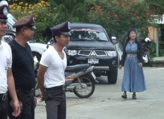Sattahip police try to ignore the smartly dressed, and very loud unidentified woman as they go through their morning formation drills.