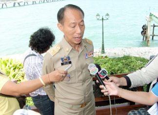 Chonburi Gov. Khomsan Ekachai answers media questions during the emergency drill.