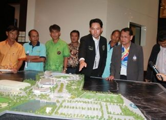 Mayor Itthiphol Kunplome and Maj. Gen. Osoth Bhavilai look over plans to renovate the Pattaya Indoor Sports Arena to make it the nation's main venue for disabled athletes.
