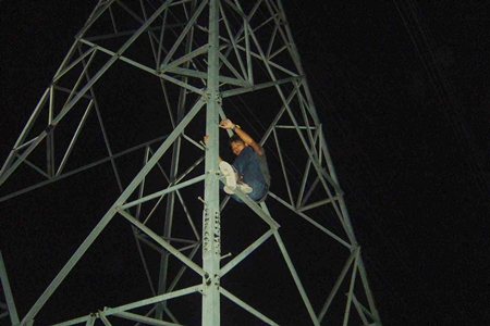 Wijit Saothong climbed an electricity tower and refused to come down.
