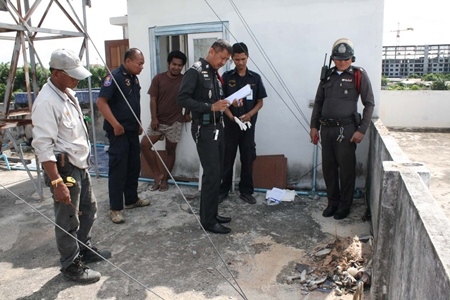 Police inspect the area where the bones were found.