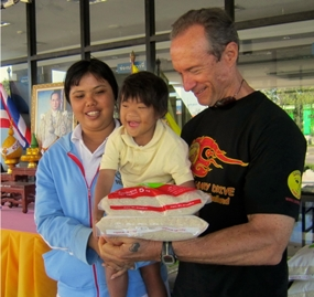 Jesters sponsor a monthly rice and milk distribution to poor families with disabled children, at Nong Prue Municipality.