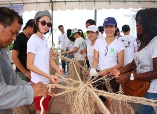 Holiday Inn Pattaya and Ibis Pattaya Hotel employees make artificial trees from ropes to be dropped in the Naklua Reefs Preservation area.