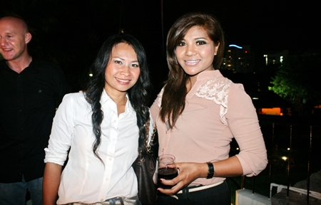 Smiling property consultants Piyanuch Puangkhamnuan (left) and Prapai Sema (right) from Enjoys Property Co., Ltd.