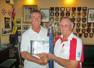 The scribe, right, presents the 'MBMG Golfer of the Month' award to Mike Gaussa.