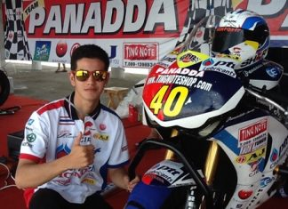 Ben Fortt poses next to his Honda CBR 1000cc race bike.