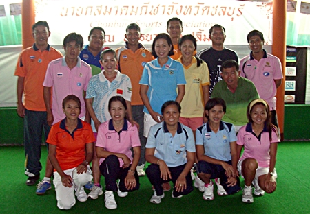 Thailand's elite lawn bowlers pose for a photo at the Coco Club in Pattaya, Sunday, Sept. 2.