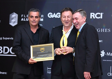 Nigel Cornick (right), CEO of Kingdom Property, presents the 'Best Condo Eastern Seaboard' award to Rony Fineman (center) and Kobi Elbaz (left).