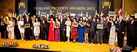 Winners pose on stage with their awards at the Dusit Thani Hotel, Bangkok.