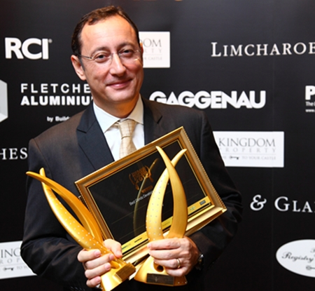 Piaras Moriarty, Vice President Client Management, Sales and Marketing at Raimon Land is all smiles after picking up awards for The River condominium in Bangkok.