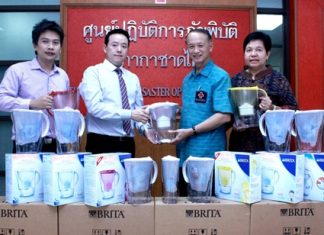 Dr. Manu Leenawong (2nd left), MD Aqua Innotech (Thailand) Co., Ltd., together with GM Suradej Darayen (left), donate 60 Brita Water Filters valued at 101,400 baht to Lt. Gen Dr. Amnat Barlee (2nd right), director and Miss Assara Petkong (right), the vice director of the Thai Red Cross Relief and Community Health Bureau for use in emergencies in aid of flood victims throughout Thailand.