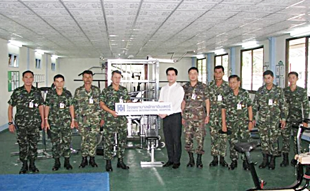 Lt. Col. Sutthichai Sornlump, commanding officer of the 2nd Infantry Battalion, 21st Infantry Regiment, Queen's Guard receives a generous donation of fitness equipment from Panond Viravaidya, executive of the Pattaya International Corporation (Thailand) Group of companies representing the Pattaya International Hospital and Sugar Hut Resort. The military fitness program is code named 'Twenty First Fitness'.