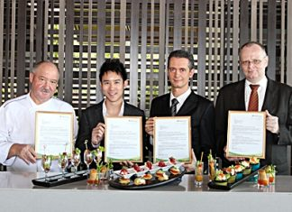 Four of the Royal Cliff Hotels Group's 11 restaurants recently received top honors from Trip Advisor. Proudly showing off their awards are (l-r) Executive Chef Walter Thenisch, Executive Director Vitanart Vathanakul, General Manager Christoph Voegeli and Senior Food & Beverage Director Max Josef Huber.
