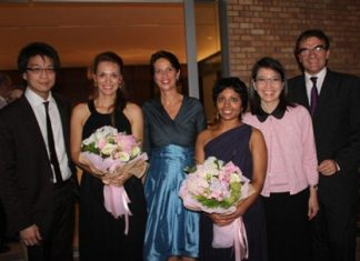 Swiss ambassador, Christine Schraner-Burgener (3rd left), poses with the two artists and other guests at the conclusion of the concert on Sept. 21 in Bangkok.