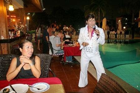 Elvis Presley is 'all shook up' as he excites the audience into a frenzy.