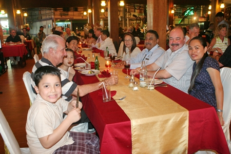 The Corness family (left) along with Peter Malhotra and the Levy family prepare for an evening of good food and fun.