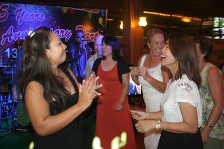 The jubilant crowd dances the night away.