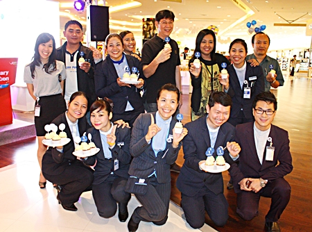 Operations Manager Prasong Nitinavakorn (center) and employees celebrate King Power Pattaya Complex's 1st Anniversary.