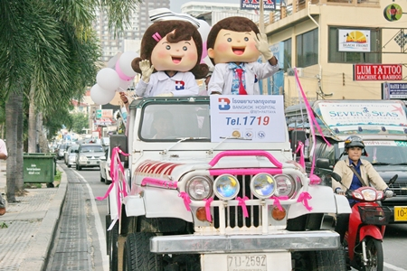 Mascots from Bangkok Hospital Pattaya hitch a ride on the BHP jeep during the parade.