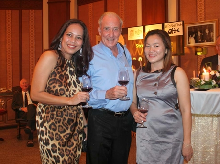 """A doctor between two roses (l-r) Teatree Spa Manager Papakan """"Jeena"""" Saguansap, Dr. Iain and Som Corness."""
