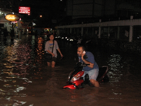 The leading edge of Tropical Storm Gaemi packed a major punch, causing floods throughout Pattaya.  Here, a tourist tries to evacuate his motorcycle from Soi Marine Plaza just off Waling Street late Friday night / early Saturday morning.  But as the entire kingdom battened down the hatches, expecting the worst, the storm lost strength over land and fizzled as it passed overhead.