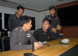 Throngkrit Thongnath (center) said he was only trying to break up a fight when he fired his weapon into the air near Bali Hai pier.