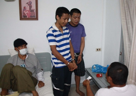 Weerayuth Pan-inth (left) and Lertmongkol Thitiwonno (right) are arrested inside a Plutaluang hotel room.