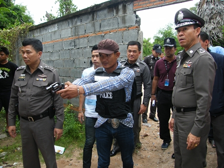 Sahas Butdoi reenacts the murder for police and reporters.