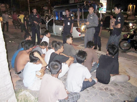Police round up the Bangkok teens who were in Jomtien ready to rumble with a cache of weapons (Below).