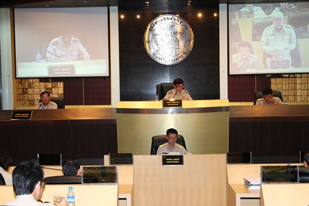 Thawit Chaisawangwong (center, back) presides over the latest city council meeting about flood control and wastewater treatment projects for next year.