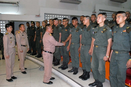 Capt. Chusak Bunthat congratulates students of the Thai Marine Corps Officer Advanced Training course.