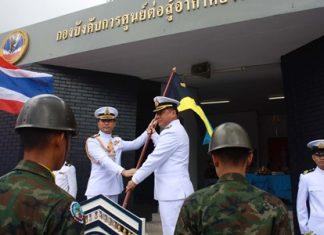 Outgoing commander, Capt. Buan Mattawanukul (left) hands over the leadership flag to Capt. Somprasong Wisoldilokpanth.