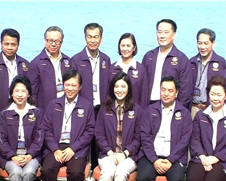 Prime Minister Yingluck Shinawatra (seated, center) and some of her top ministry officials meet at the Sheraton Pattaya Resort.