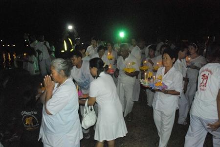 Hundreds of vegetarians release vegetable krathongs as part of the vegetable festival in Sattahip.