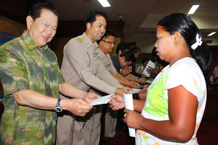 MP Santsak Ngampichet (left), president of the Religion, Art and Culture Committee, and Mayor Itthiphol Kunplome present funds to help citizens with low income.